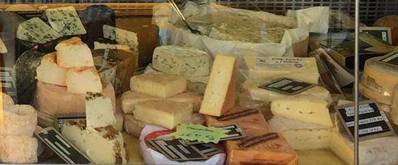 Market stall with an array of French cheeses